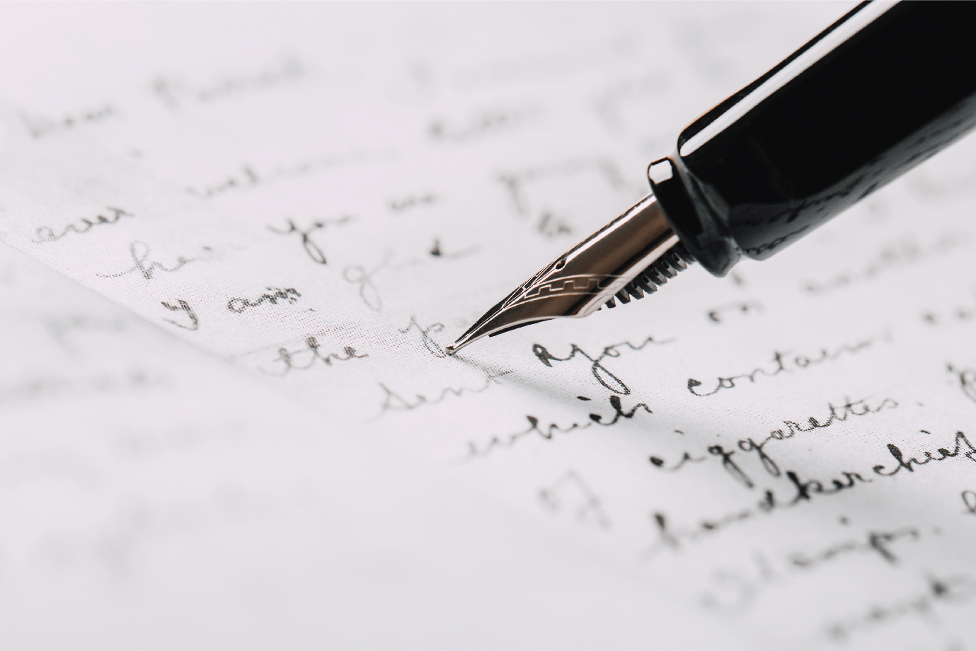 A letter being written with a fountain pen