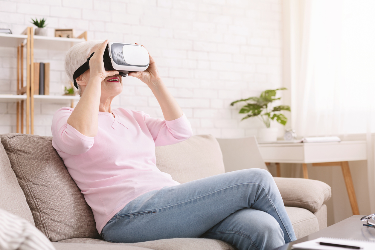 Woman looking through virtual reality glasses